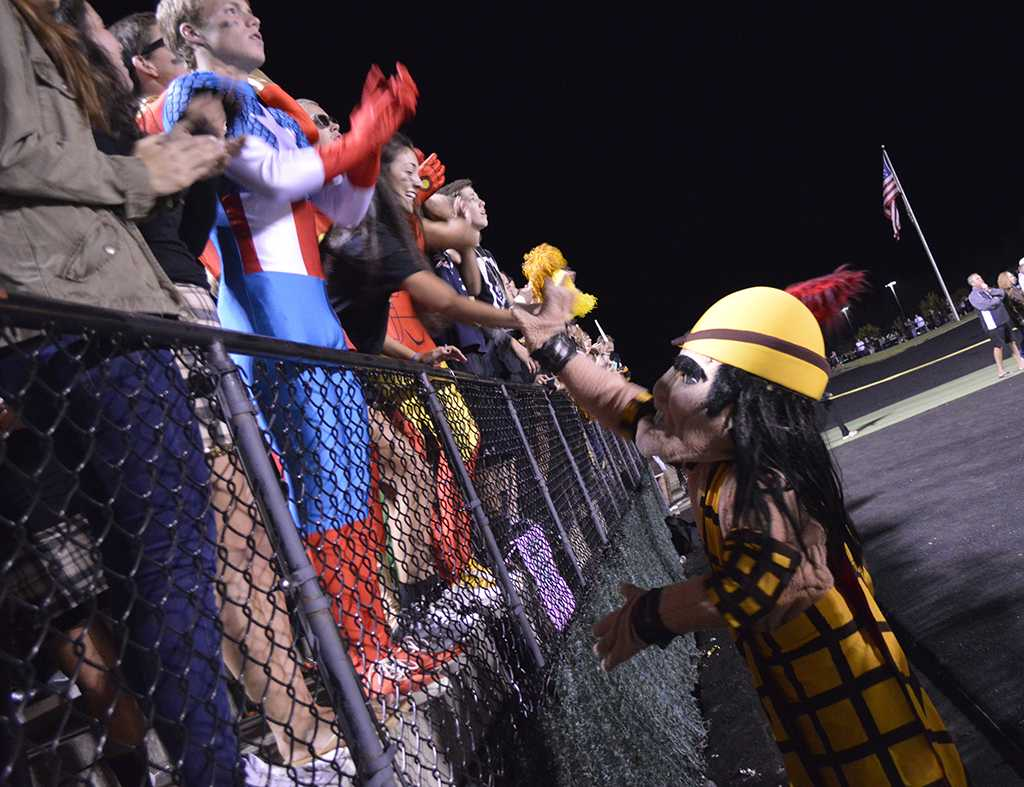 The+Highlander+greets+cheering+super-fans+at+the+Homecoming+Game.+