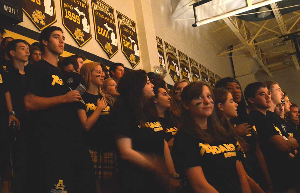 Students+stand+for+the+national+anthem+at+the+Homecoming+Pep+Assembly.+Standing+like+this+is+now+commonplace+at+Adams+in+lieu+of+the+Pledge+of+Allegiance+mandate.+