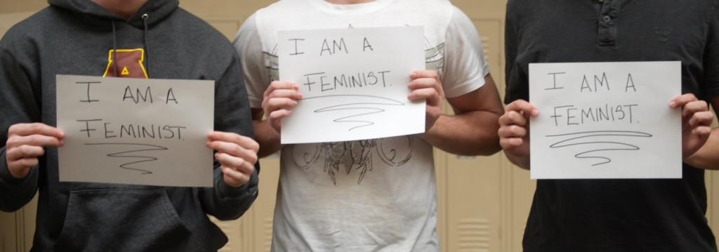 Male+Adams+students+hold+signs+in+support+of+feminism.