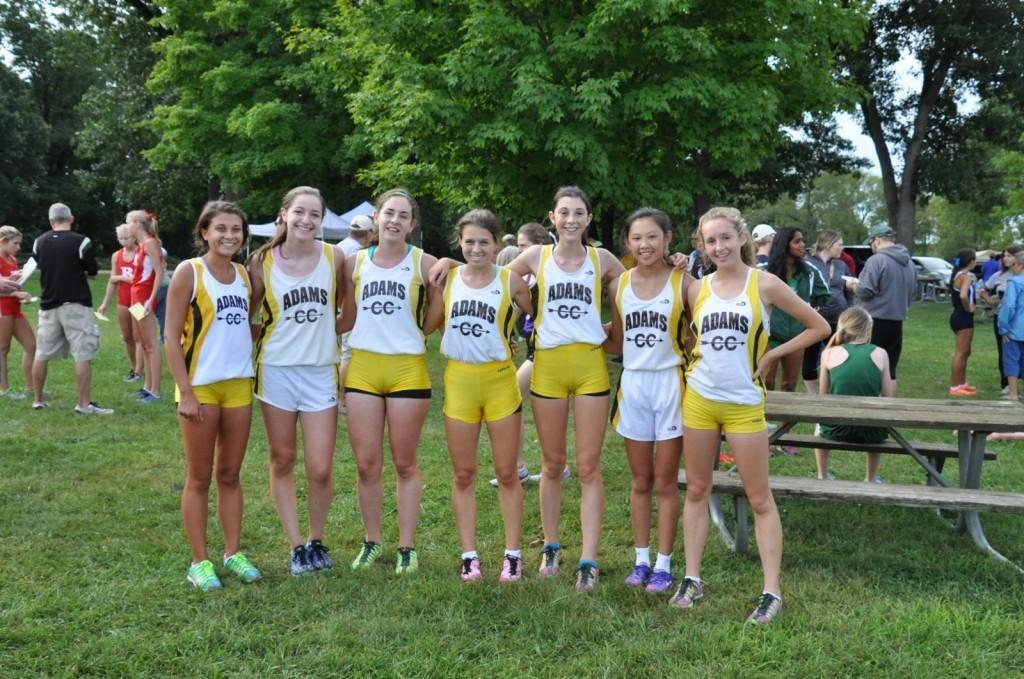 The+AHS+Cross+Country+team+poses+for+a+picture+after+their+meet.+