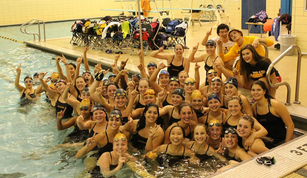 The+girls+swim+and+dive+team+celebrates+after+defeating+rival+Seaholm.