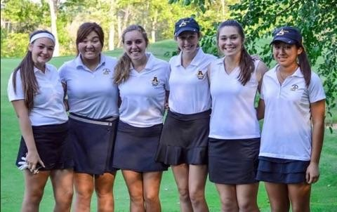 The AHS Varsity Girls' Golf team poses before their last competition.