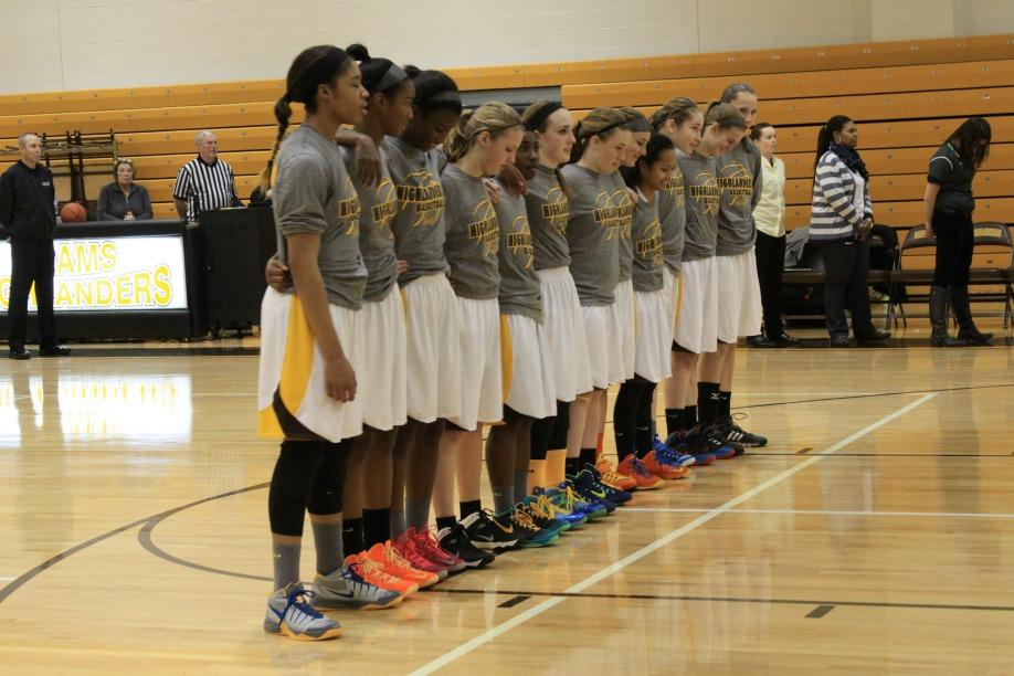 The+AHS+Girls%27+Basketball+team+lines+up+during+the+national+anthem.