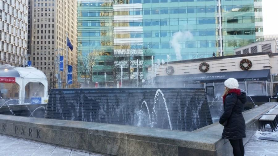 Staff+writer+Jessica+Skiff+looks+at+the+fountain+at+Campus+Martius+Park.