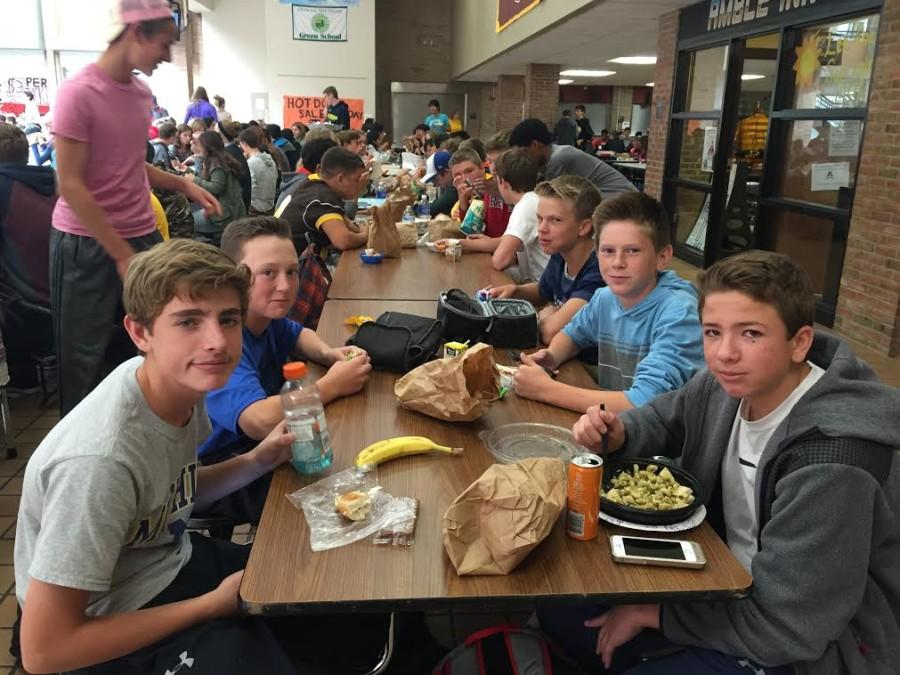 Freshman+boys+gather+around+the+lunch+table+to+eat+and+chat