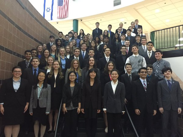 Adams DECA students pose on the staircase of Lake Orion High School