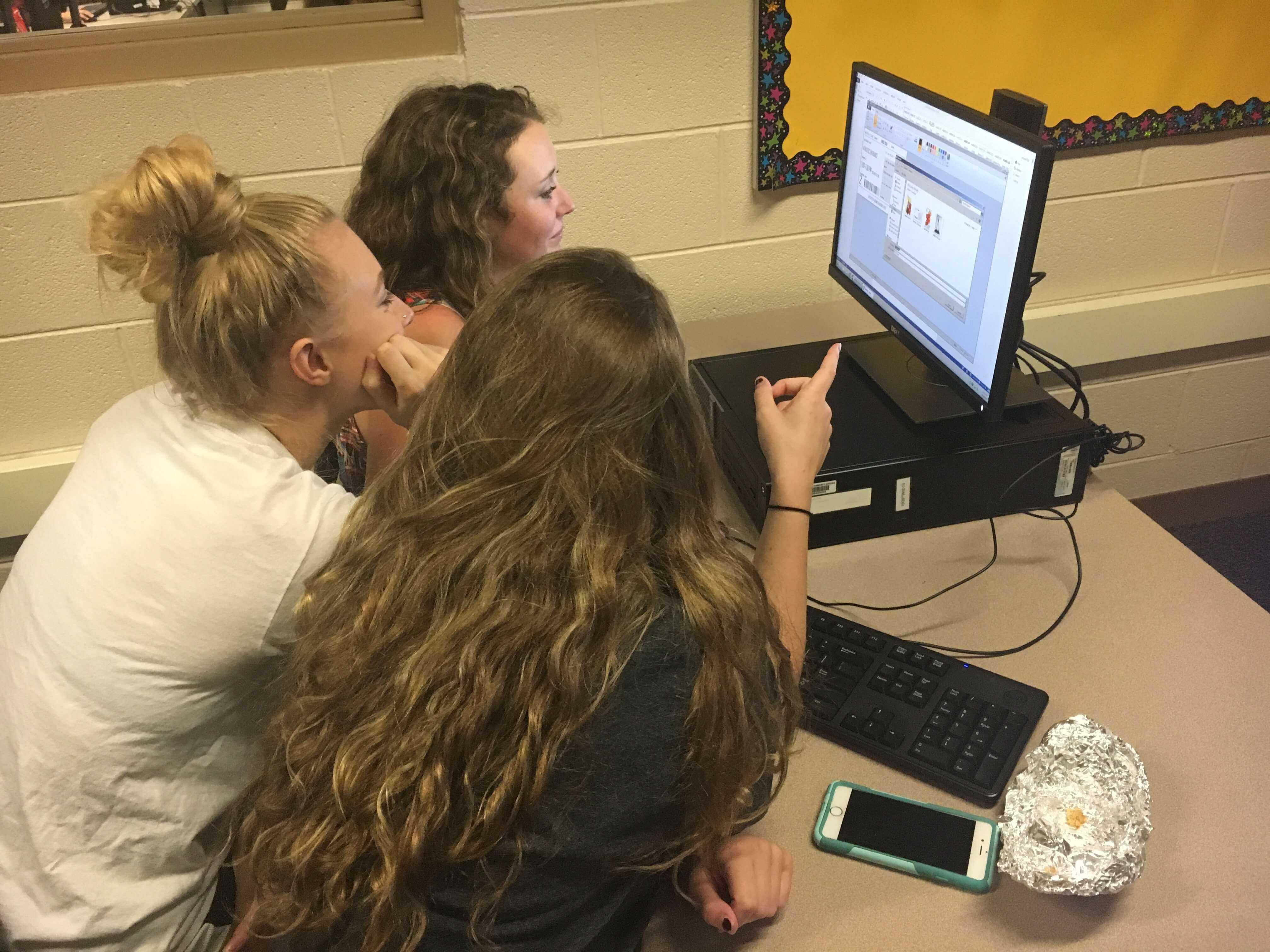 Student Council members Julia Moran, Kiley Ward, and Morgan McDonald are hard at work planning for October's festivities.