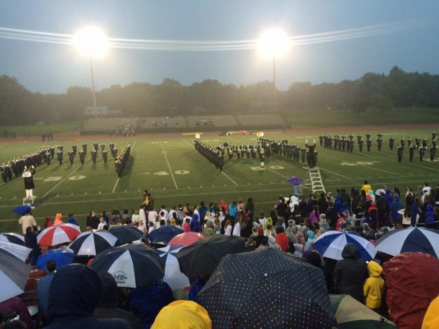 Highlander+Marching+Band+performs+a+halftime+performance%2C+spelling+out+AHS.