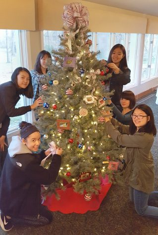 Rochester Adams Art students Nicole Kim, Nikki Ngatio, Samantha Bismack, Jean Cheng, Rebecca Wang, and Maya Yamaguchi helped decorate the tree.