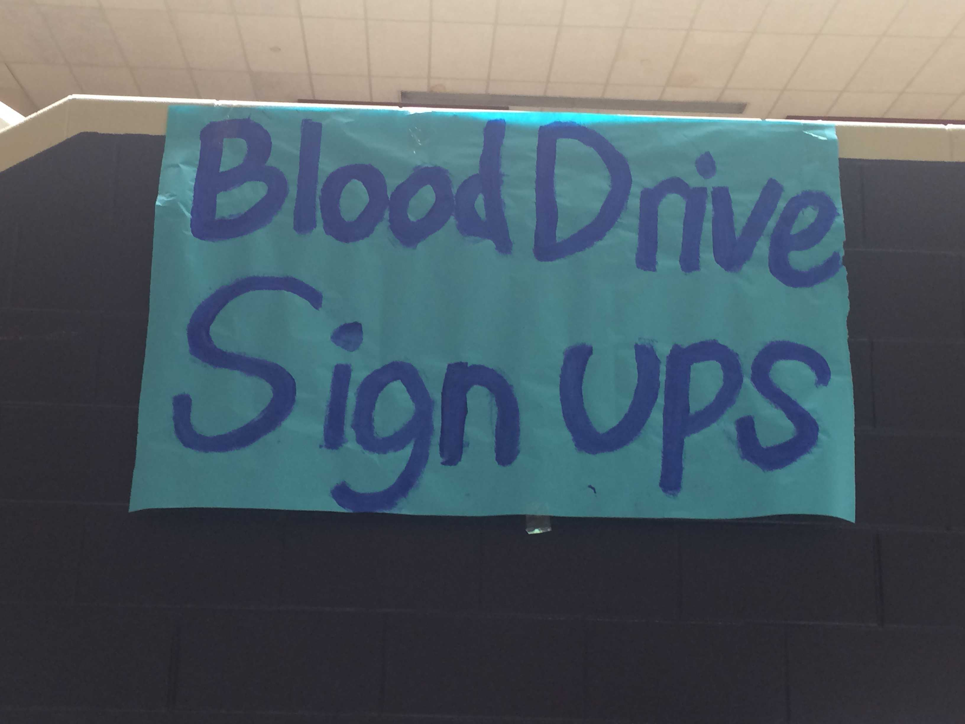 Student Council creates a banner to encourage participation in the blood drive.