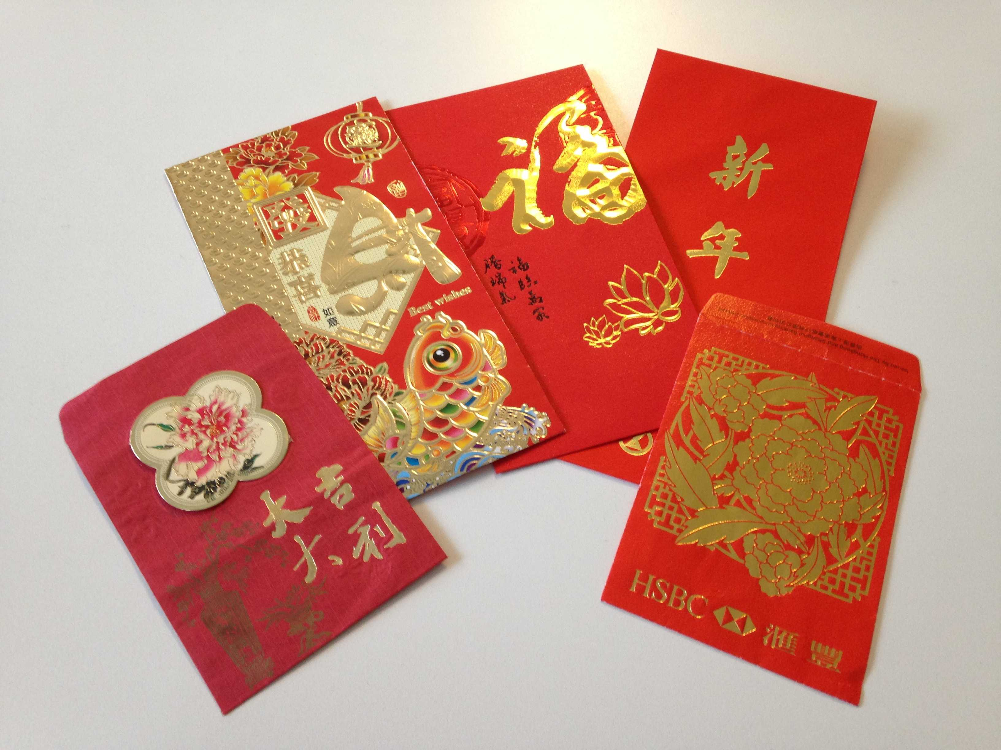 Children traditionally receive red envelopes on New Year's, containing various amounts of money.