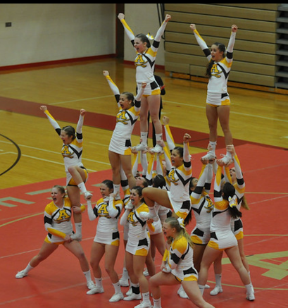 The Adams Cheer performing a round in the Regional Competition.