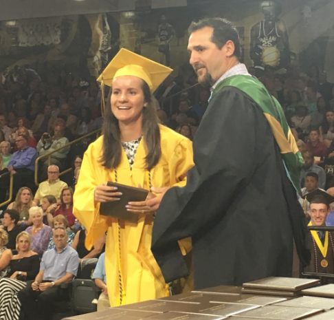 English teacher Mr. Dave Lovalvo gives his daughter, Sydney Lovalvo, her diploma. Lovalvo's two children - Sydney and Jack - graduated this year. Both seniors received their diplomas from their dad.