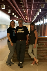 Teachers Mrs. Winkler, Mr. Wieten, and Mrs. Wieten gather for one last group photo before retiring from Rochester Adams High School.