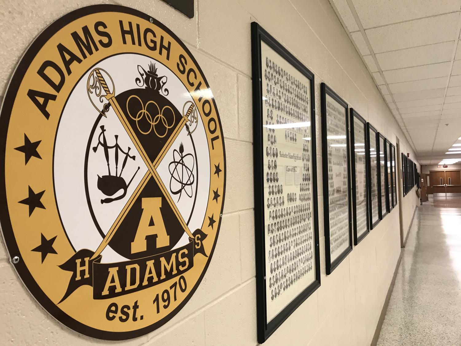 The Adams Crest proudly hangs on the entrance wall of the school.