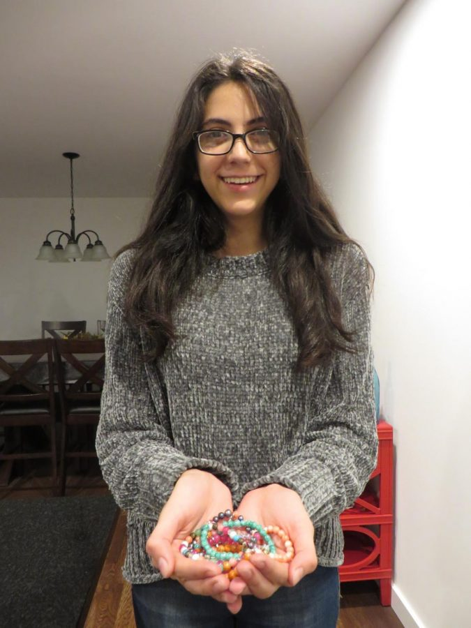 Nasiri+holding+some+of+her+handcrafted+bracelets.