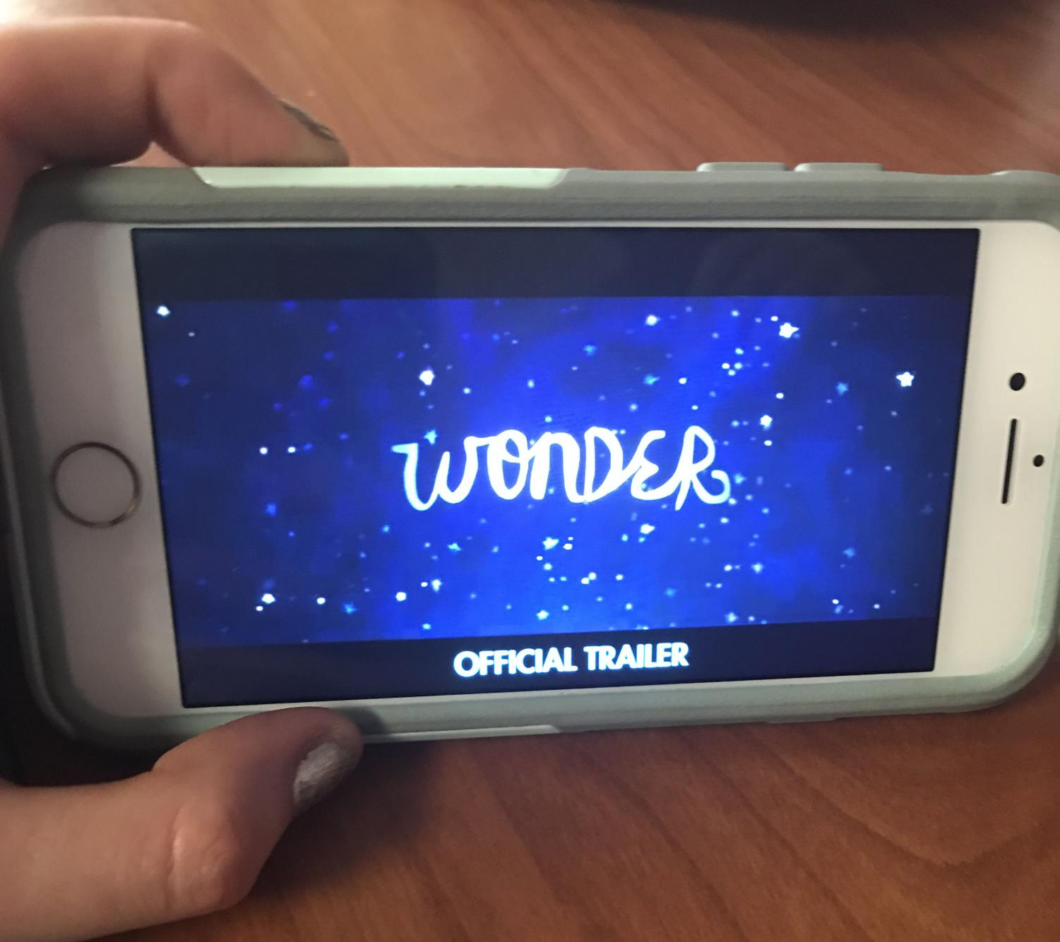 Student watches Wonder trailer on her phone.