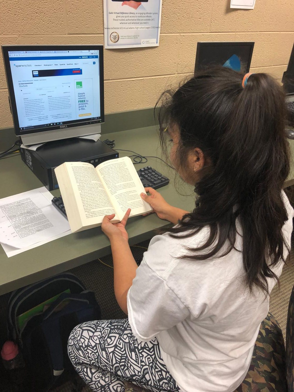 Avanthika Sinha reading her assigned novel while using Sparknotes.