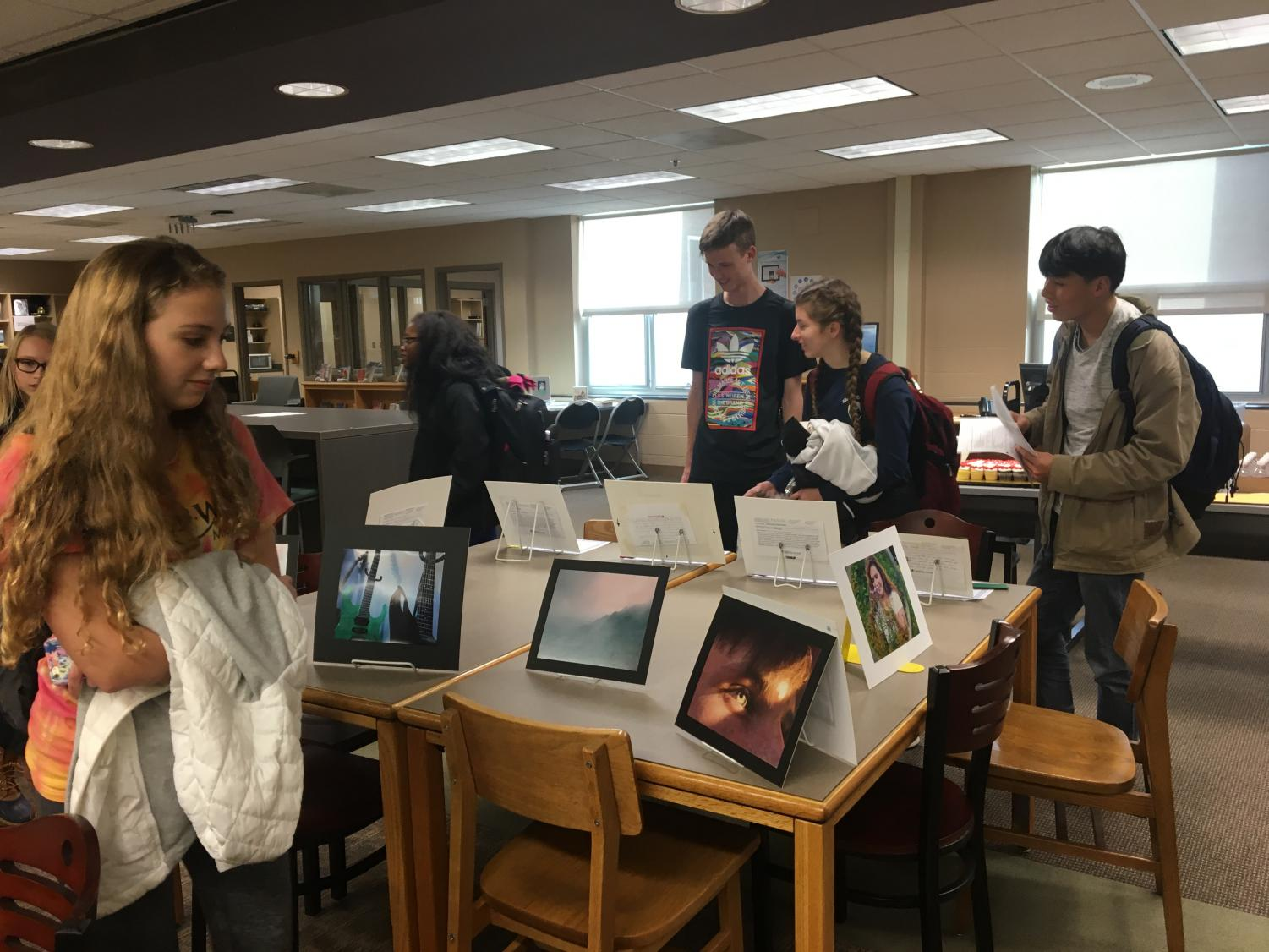 Students admiring the artwork of the Reflections gallery.