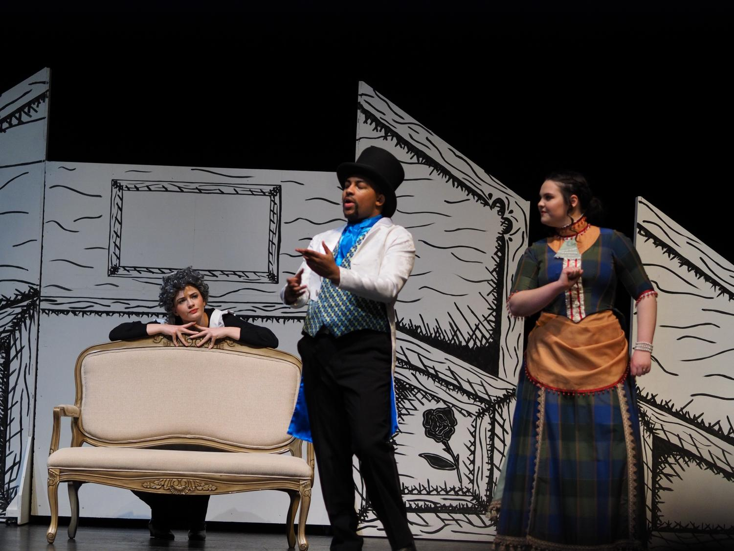 Miles Houser (center) and Katie Lane-Waters (right) plan a murder most foul as Sophia Williams (left) spies on the pair.