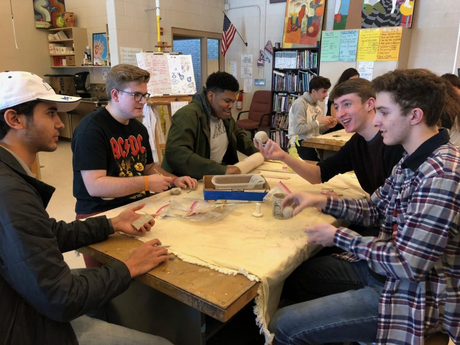 Adams+art+students+working+on+a+ceramics+project.