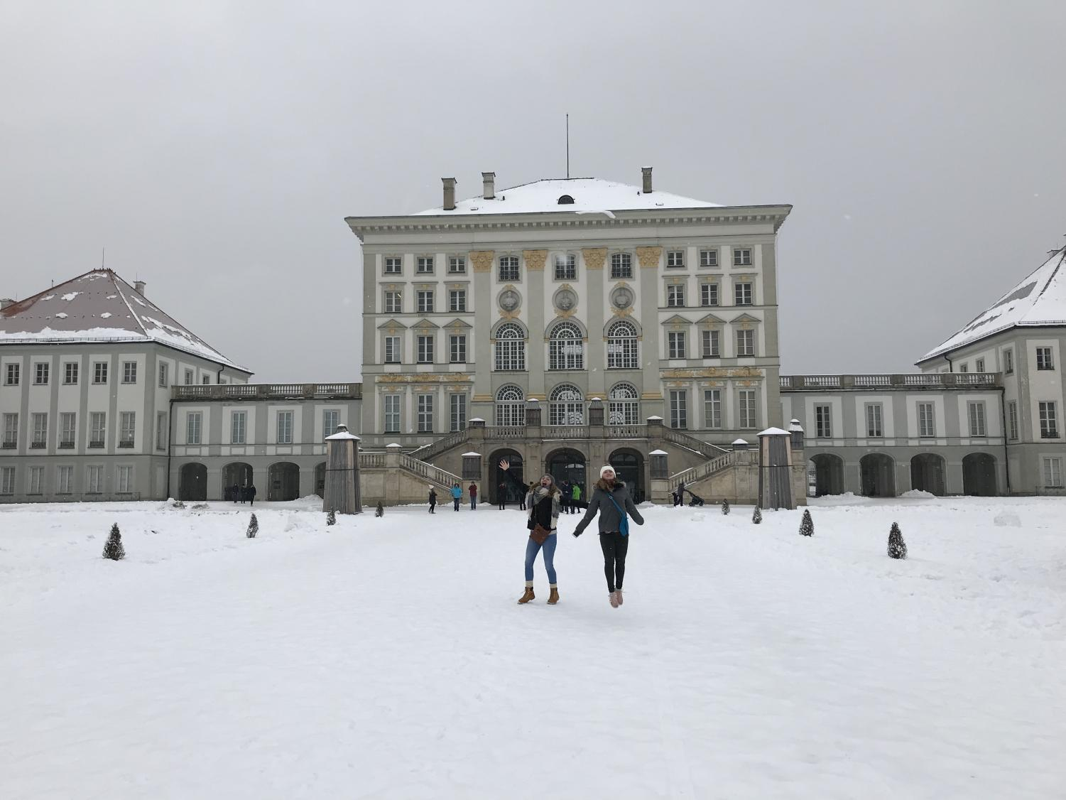 Anna Gaudreau jumping in front of a German Palace.
