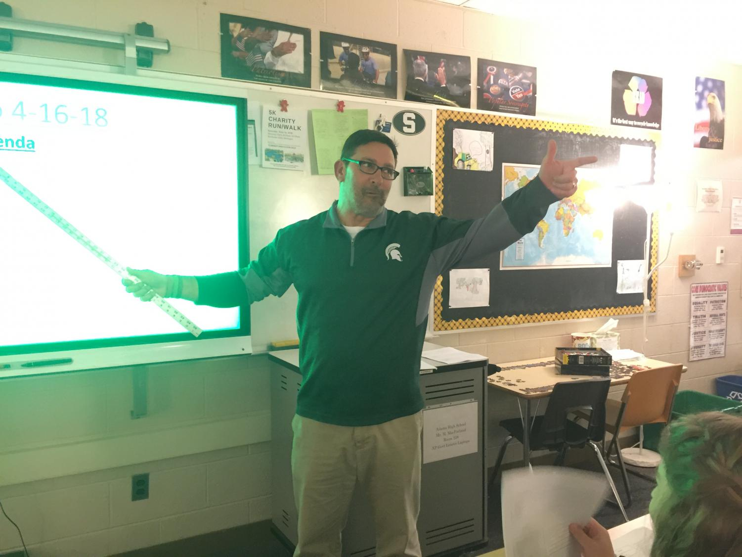 MacFarland enthusiastically directs student responses during his AP Government class.