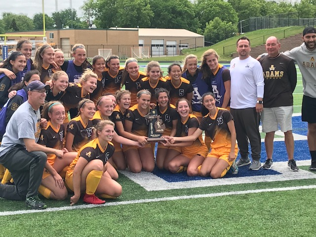 RAGS+repping+the+district+trophy+after+their+2-1+win+against+Eisenhower.