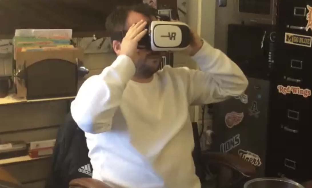 Social Studies Teacher, Josh Hickey watching a VR horror themed video.