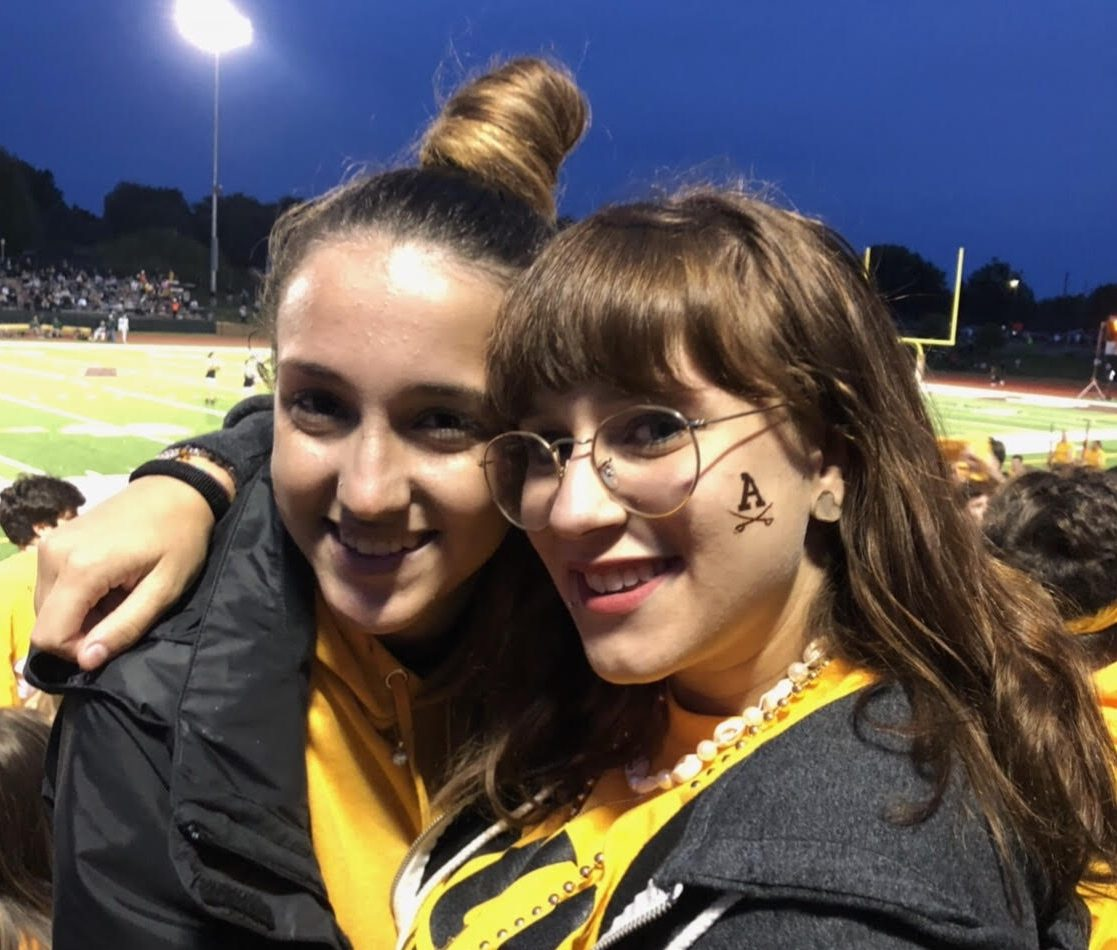 Seniors Giulia Isopo and Anna Rosace at an Adams football game.