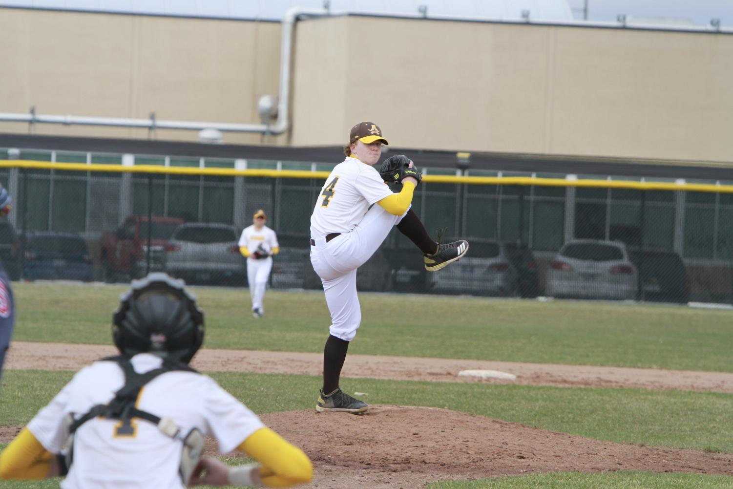 Ben Patton pitching for Rochester Adams.