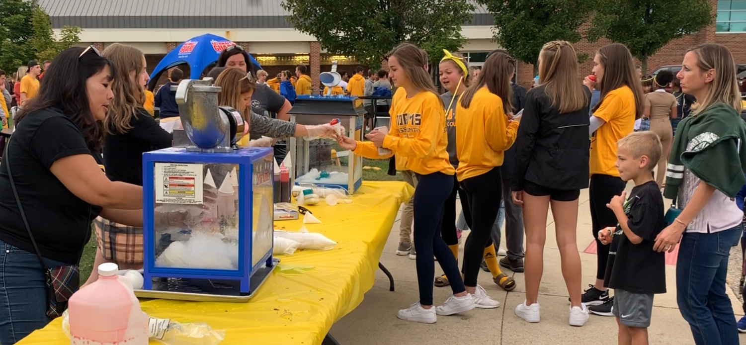 Students line up for snow cones from the PTSA.