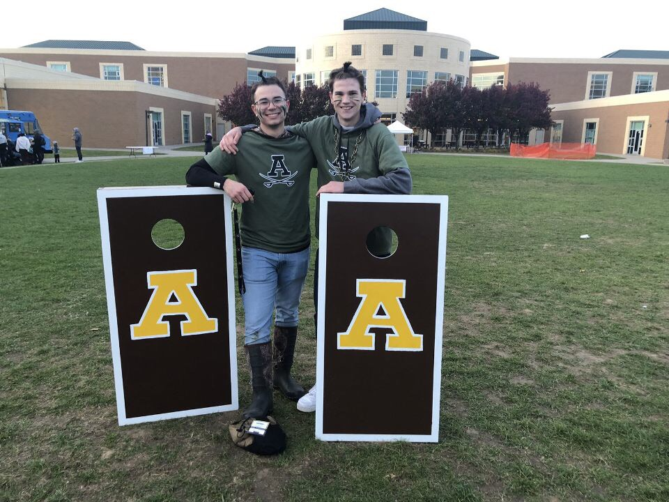 Pictured are Cornhole Champions Billy Peters (left) and Brendan Kevelighan (right)