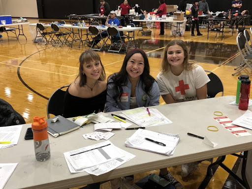 Members of Student Council signing     students up for the blood drive