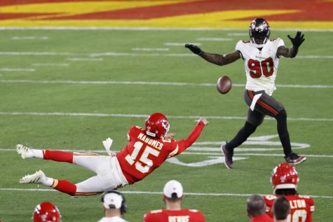 Patrick Mahomes making a diving last effort on a 4th down play.
