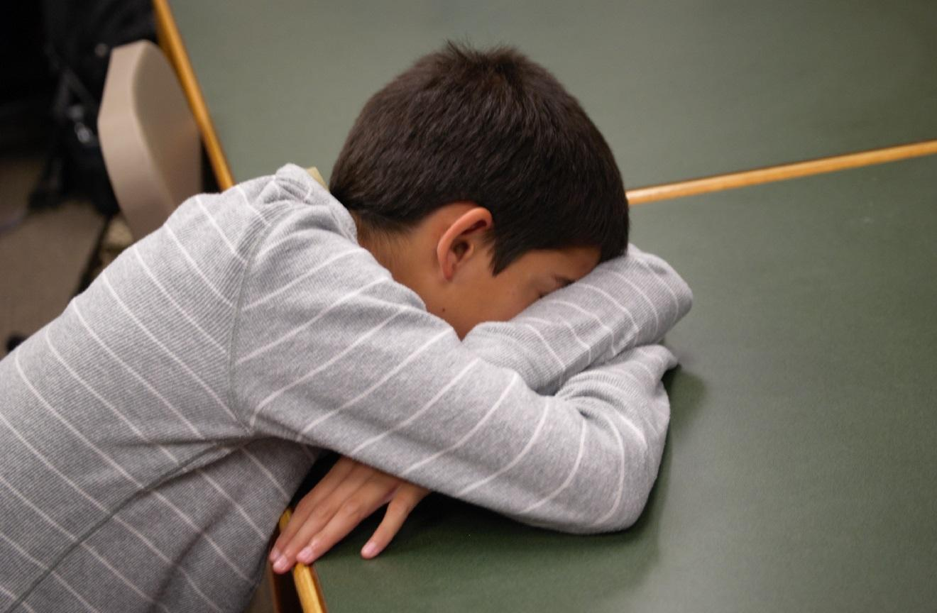 A student falls asleep in the Media Center.
