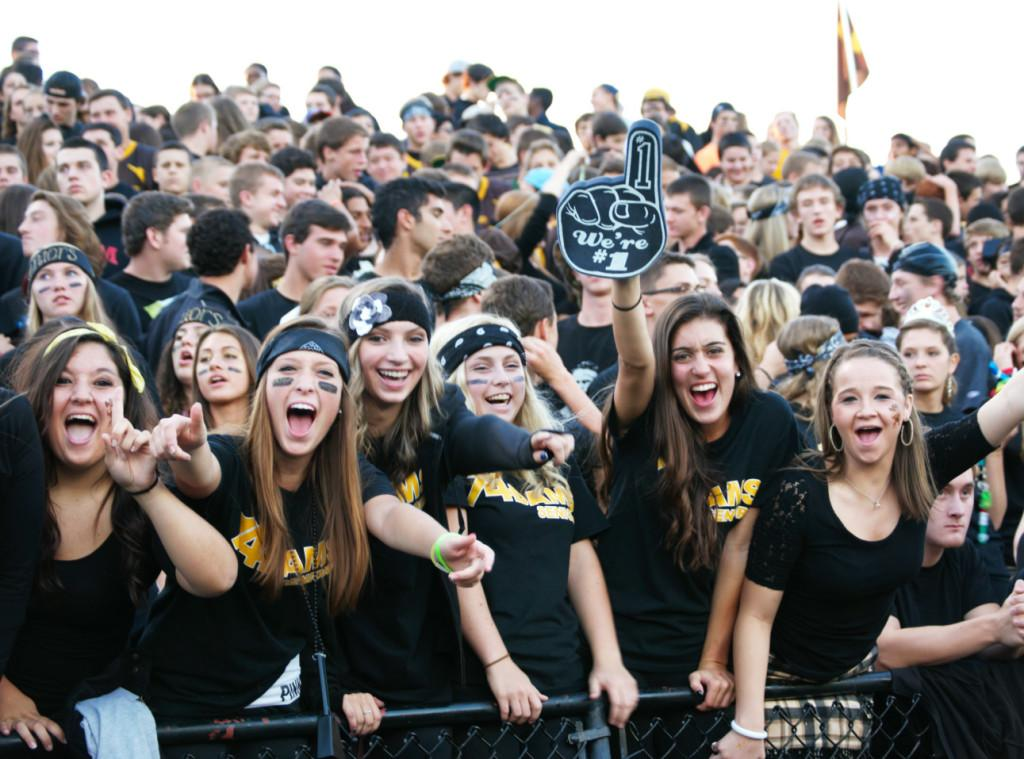 Fans cheer on the HIghlanders at a football game.