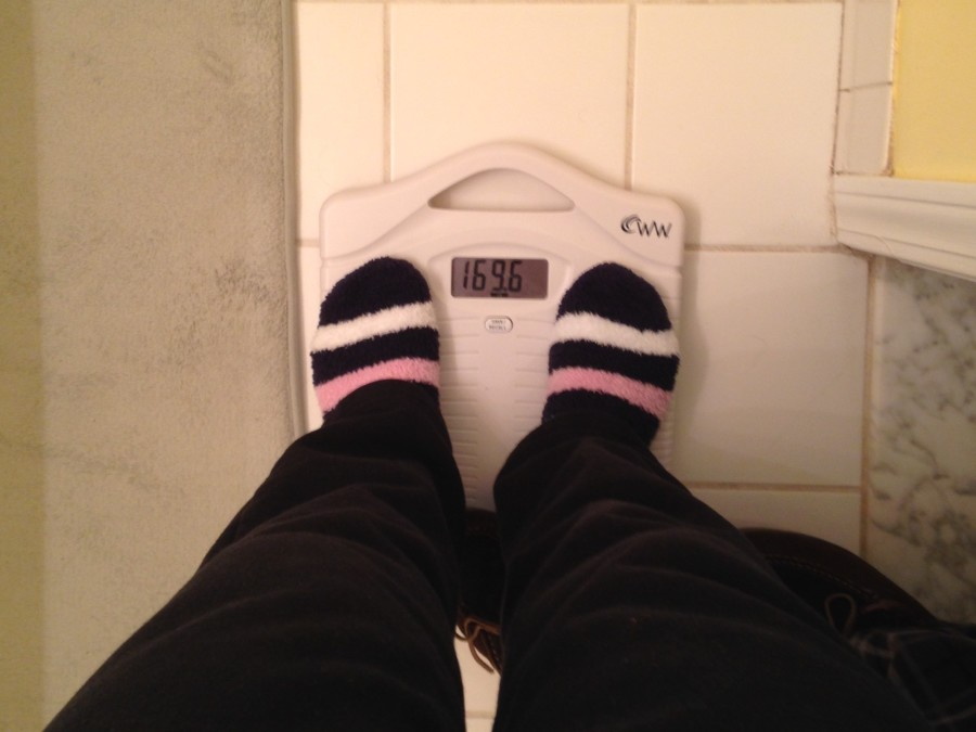 Teenage girl from Adams weighs herself on a scale