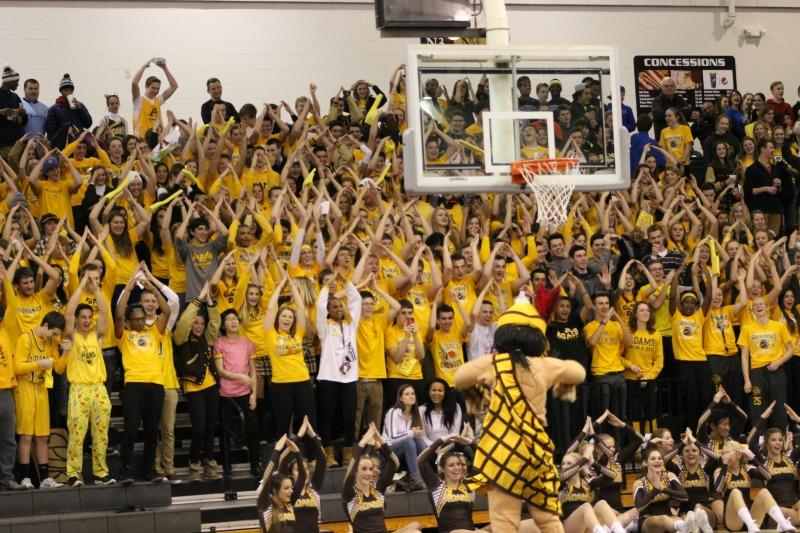 The student section does the YMCA as led by Mr. Highlander.