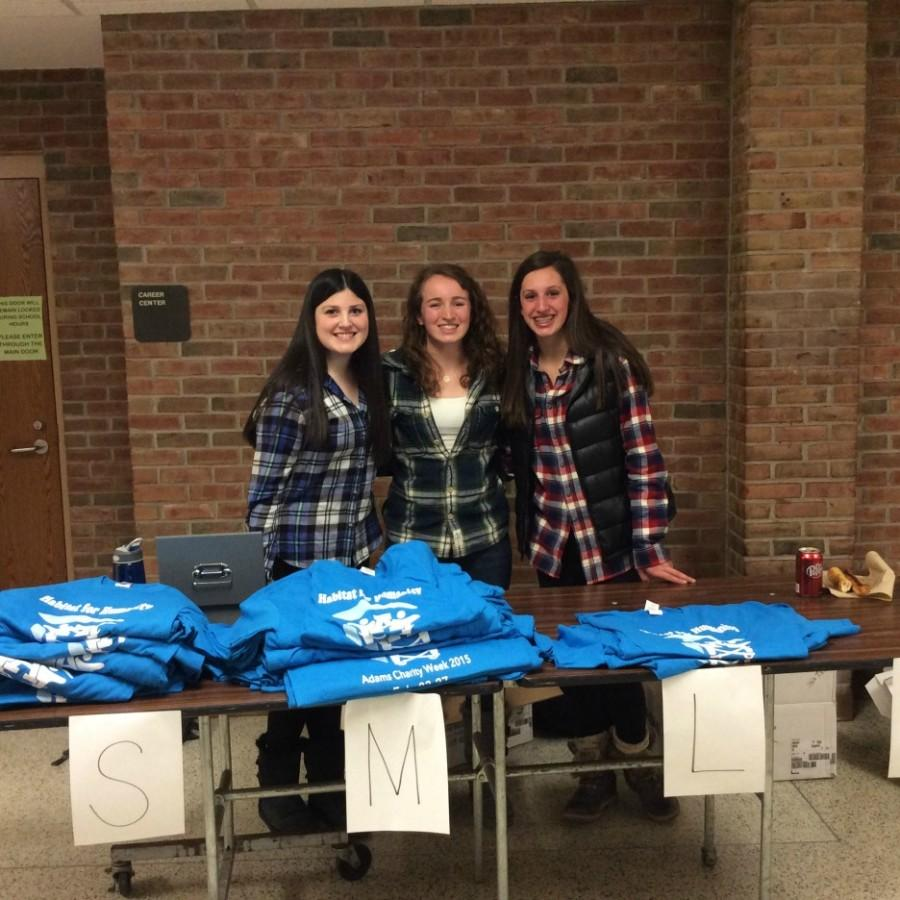 Student council reps sell charity week shirts during lunch.