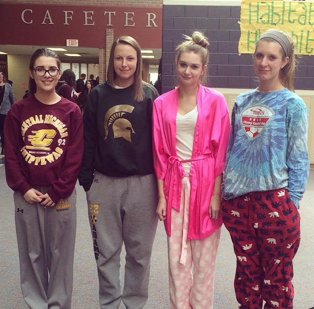 Senior girls pose in their pajamas on PJ day during charity week.