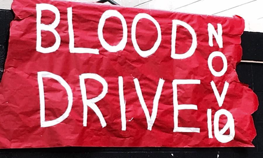Student+council+promotes+the+blood+drive+with+banners+hung+in+the+senior+area