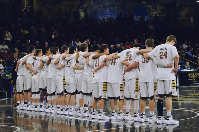 The+boys+stand+together+during+the+national+anthem+in+preparation+of+defeating+Rochester