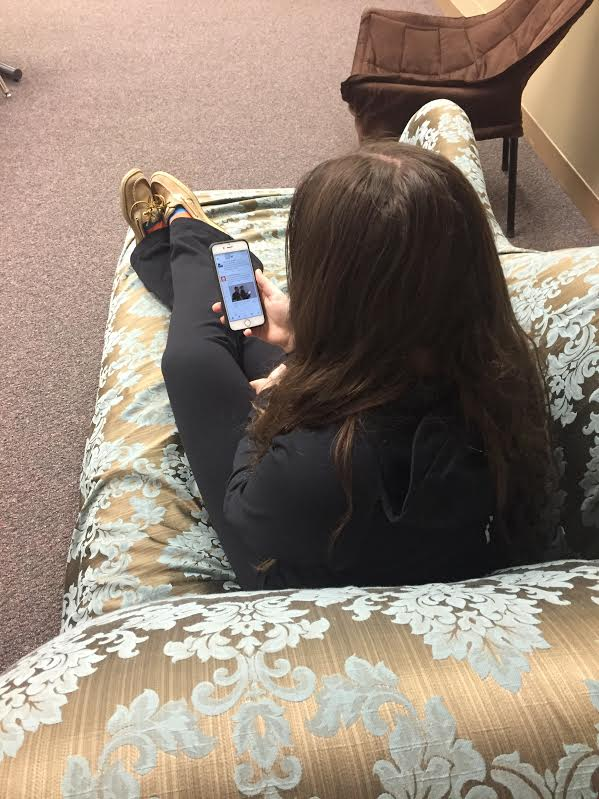 Senior Gabby Solon experiences FOMO as she sits at home and scrolls through Twitter