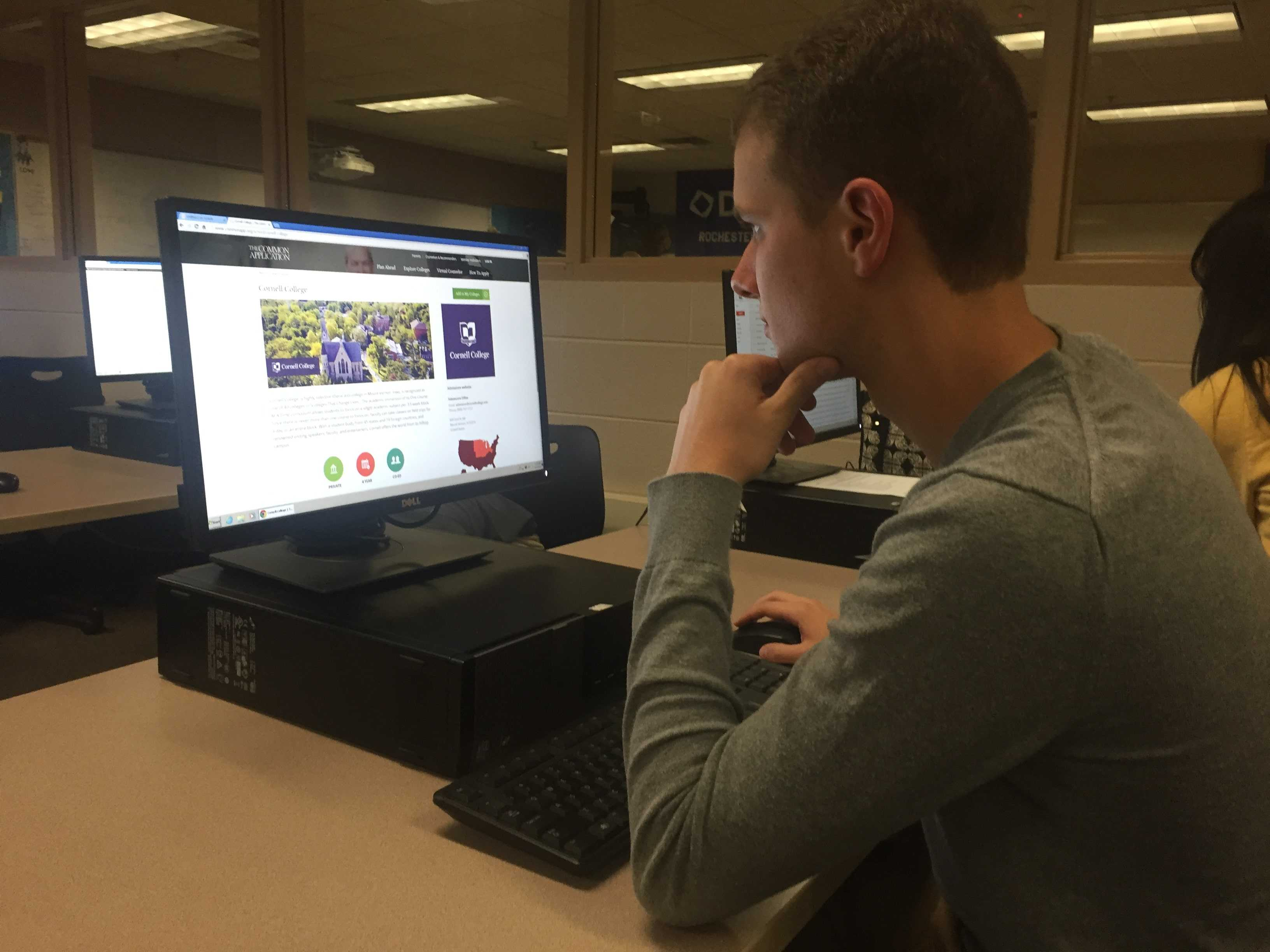 Adam Garfinkle signs onto Common App in preparation for applying to colleges.