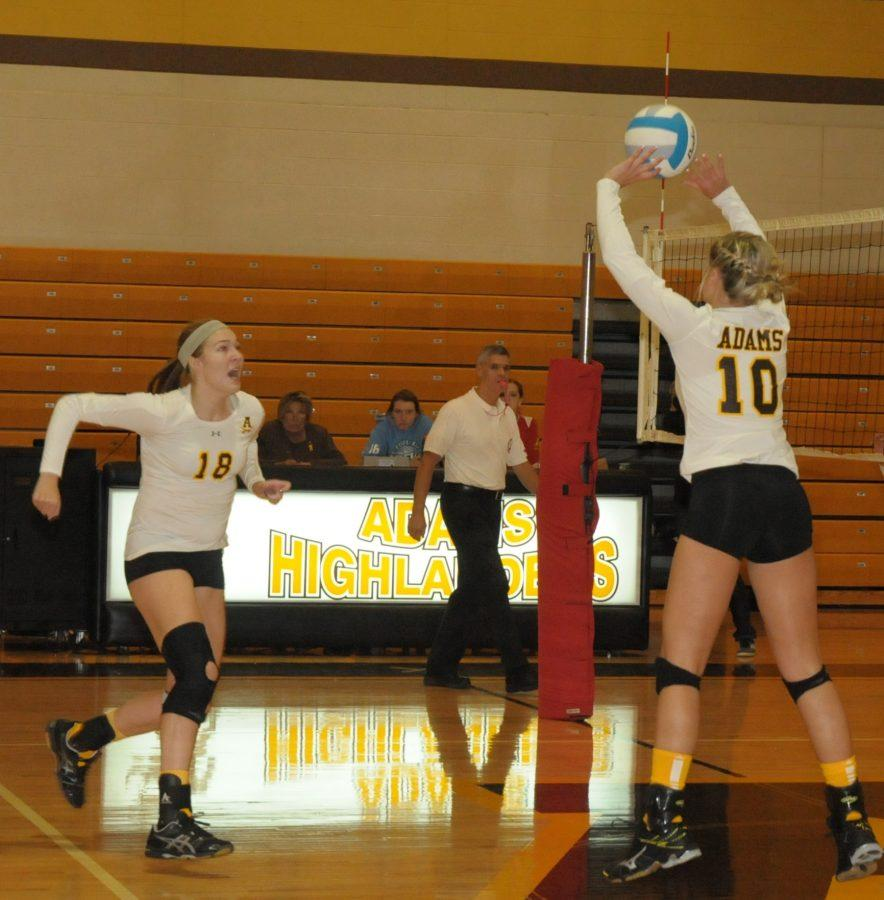 Senior Madison Tuscany ready to spike the ball over the net for a score.
