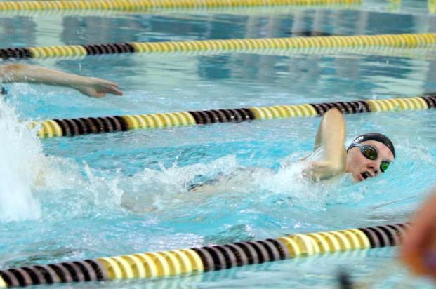 Senior+Meghan+Brown%2C+a+member+of+the+Girls+Swim+and+Dive+varsity+team%2C+competes+against+North+Farmington+High+School+on+September+8.