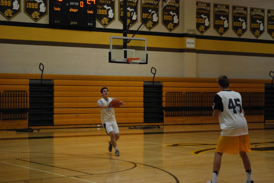 Senior player Jack Lovalvo passes the ball to a teammate during practice.