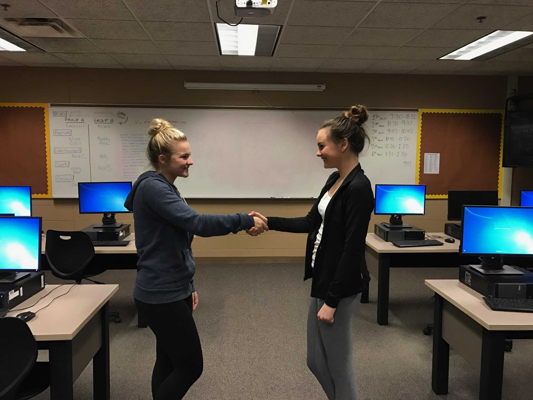 This display illustrates a peaceful exchange of power between two people with a different set of characteristics and beliefs. (Left to right: Maddy Fleury, Elise Delikat)