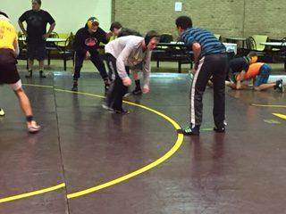 Freshmen Kenny Jackson wrestles teammate Roman Lopez at practice.